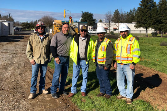 A group of cement masons stand together to represent a lifelong career